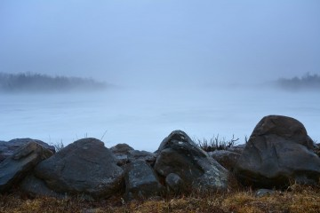 Fog and ice covering the lake.
